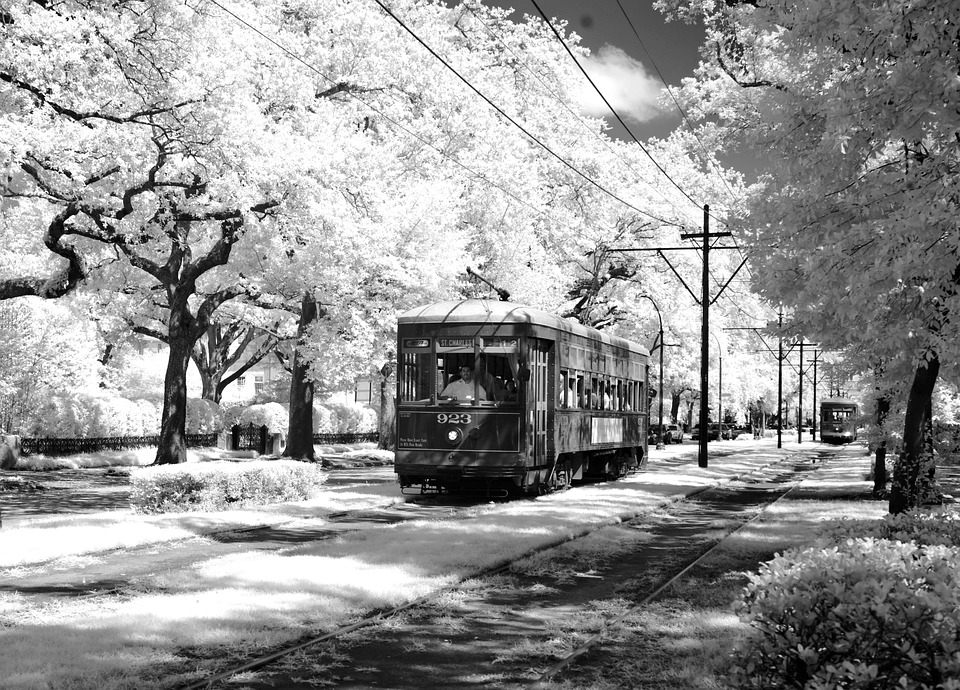 Black and White image of New Orleans streetcars in the Spring, equipped with TMV control system