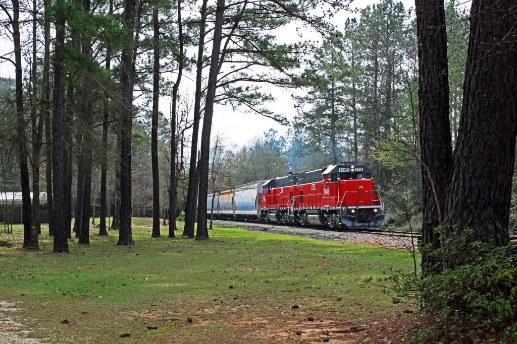 Red LTEX train, GP15, riding the rails through the woods