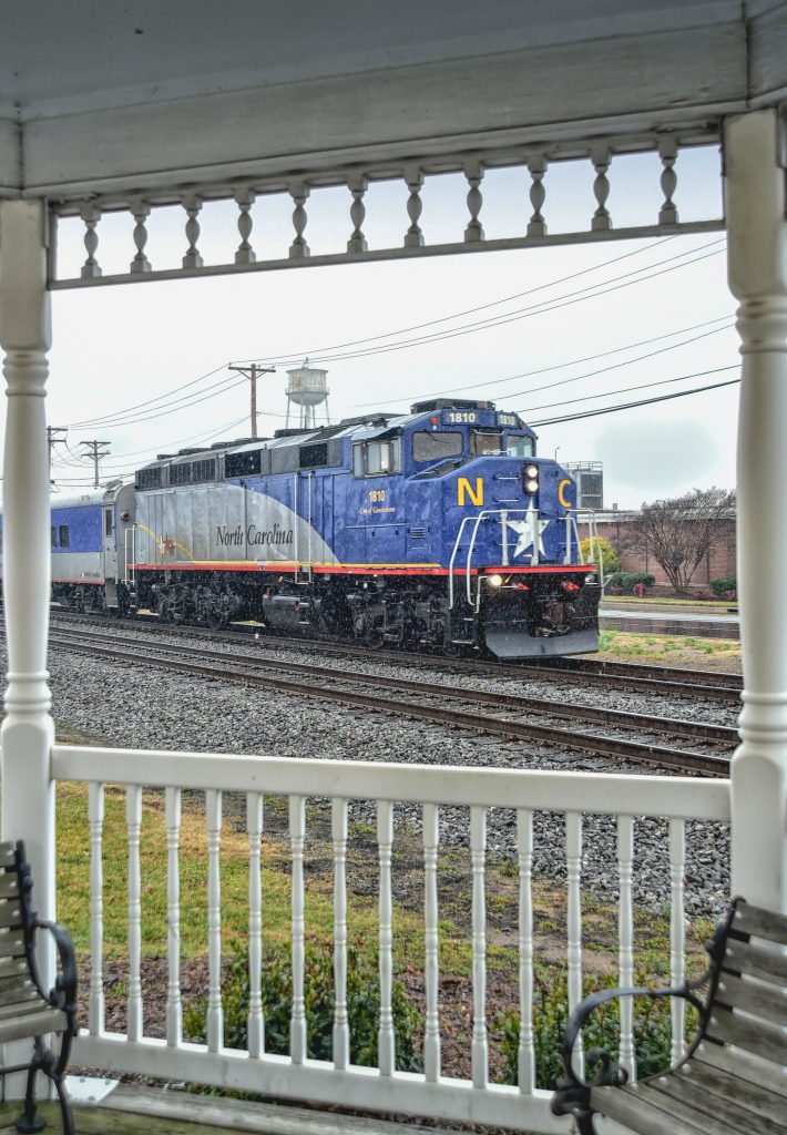Blue NCDOT F59PH locomotive #1810 front porch view