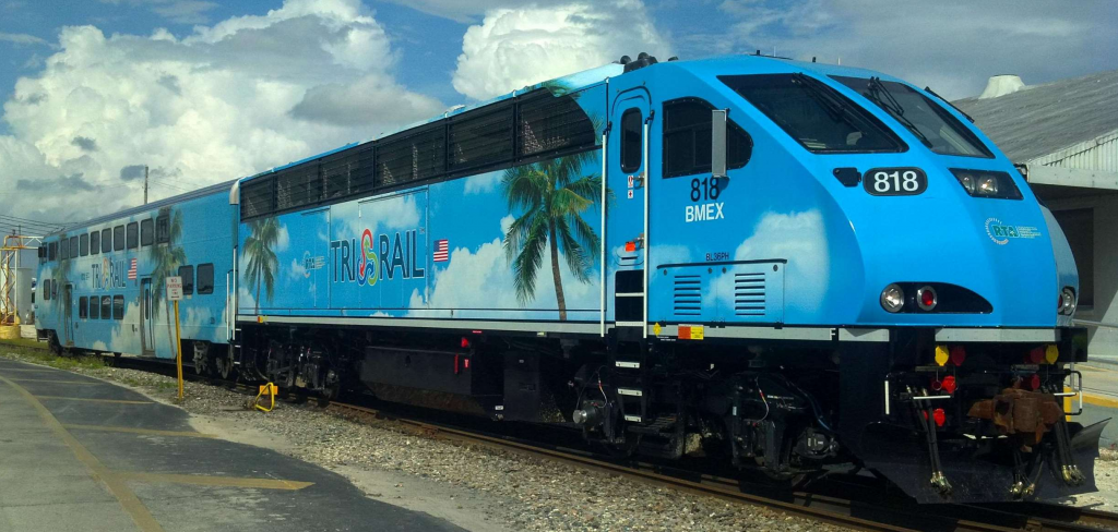 blue passenger train BL36PH from Tri Rail with palm tree decal