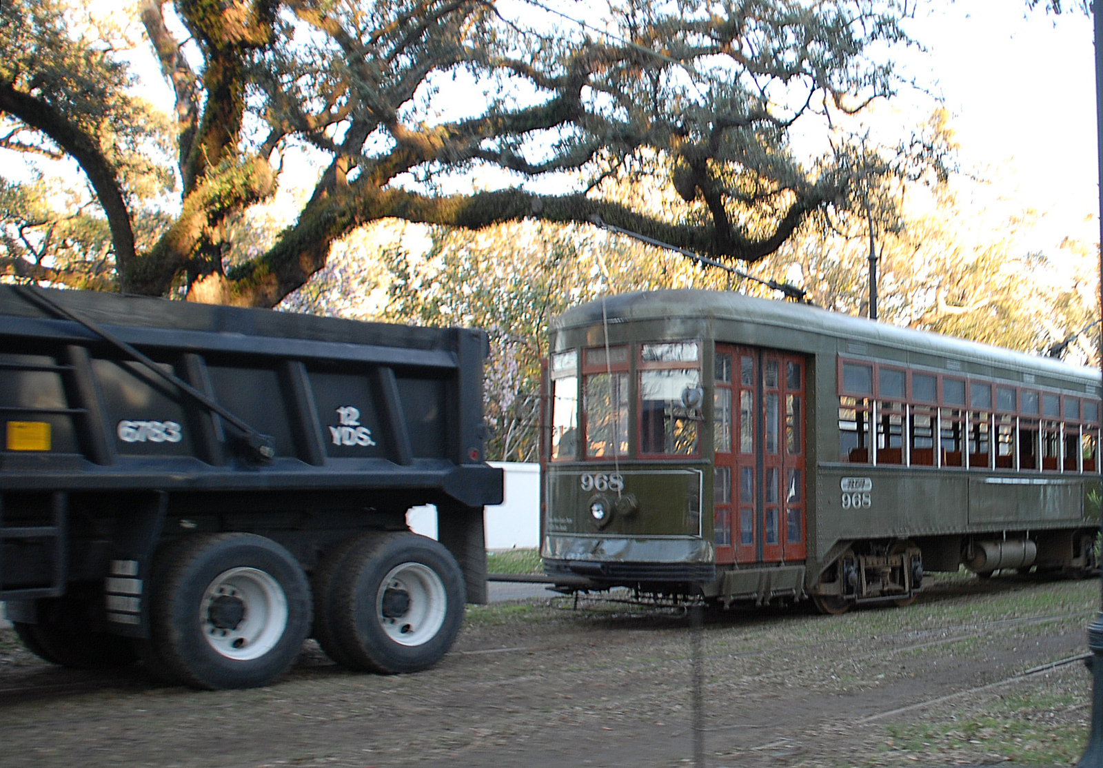 Streetcar being pulled by a transit worker truck, no electric power, repairing new orleans tracks and lines Hurricane Katrina